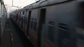 Two trains passing each other at the train station in Mumbai. MUMBAI, INDIA - 12 JANUARY 2015: Two trains passing each other at the train station in Mumbai stock footage