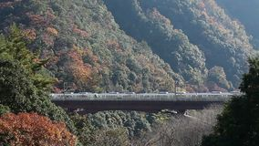 Two trains passing opposite direction at Hozukyo station Kyoto Japan stock video
