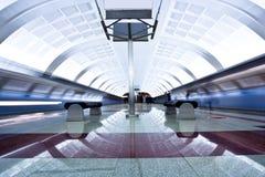 Two trains on platform Stock Photo