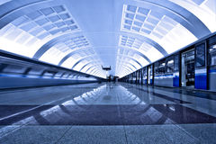 Two trains on platform Royalty Free Stock Photos