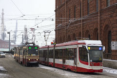 Two tram going towards each other on the street under snow, wint Stock Photo