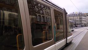 Two tram transportation meet each other going in different directions on the street Strasbourg city, France. Capital and largest c stock video