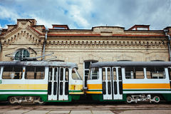 Two Trams. Two colourful trams at depot Royalty Free Stock Photo