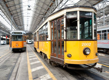 Two trams in a Milan's depot. MILAN, OCTOBER 2: Milan's Transportation Company ATM opens his tram depots to the public in Milan, on October 2, 2010 Royalty Free Stock Photos