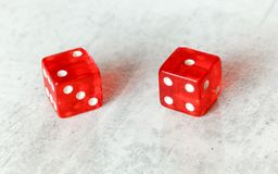 Two translucent red craps dices on white board showing Ace Deuce number 2 and 1 stock photography