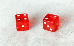 Two translucent red craps dices on white board showing Easy Six Jimmie Hicks umber 4 and 2 royalty free stock photos
