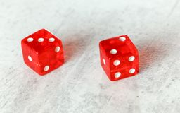 Two translucent red craps dices on white board showing Fever Five Little Phoebe number 3 and 2 stock photography