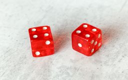 Two translucent red craps dices on white board showing Hard Eight from Decatur double number 8 stock images