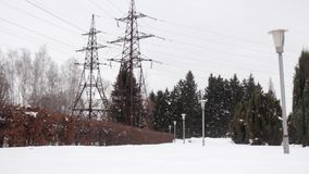 Two TRANSMISSION LINE power transmission line in a park with lanterns. HD stock video footage