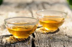 Two transparent cups of black tea on old wooden board in bright Stock Photography