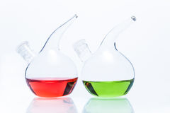 Two transparent glass dropper bottles with color liquid Royalty Free Stock Images