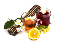 Two transparent mugs with drinks, a rug and a flower branch with Stock Photo