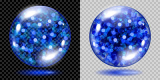 Two transparent spheres with blue sparkles. Two transparent spheres filled with blue glowing sparkles with bokeh effect. Spheres with blue sparkles, glares and Stock Image