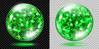 Two transparent spheres with green sparkles. Two transparent spheres filled with green glowing sparkles with bokeh effect. Spheres with green sparkles, glares Royalty Free Stock Images
