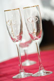 Two transparent wedding wine glasses with a heart ornament Stock Photo