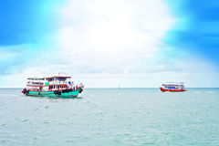 Two transport boats in blue sea stock photography