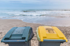Two trash cans on the beach Royalty Free Stock Photo
