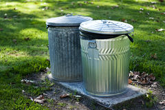 Two Trash Cans in Park Royalty Free Stock Image