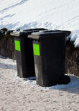 Two trash containers in winter street Stock Photo