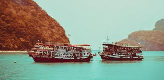 Two travel boat  stop at small island  ,Koh Samui ,Thailand. Two travel boat stop at small island ,nicece view n ,Travel concept Koh Samui ,Thailand royalty free stock photo