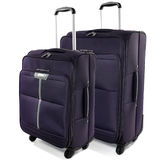 Two travel suitcases on a white background. Dark purple bags on a white background Stock Photo