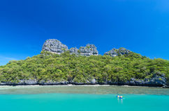 Two traveler are padding a kayak to the island on blue sky. Thailand Royalty Free Stock Photo