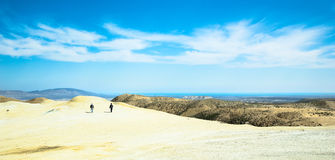 Two travelers climb to the top of the mountain Stock Photo
