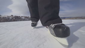 Two travelers go ice skating on a snow-covered lake. To go hard and far. This is a special kind of hike. Shot on the action camera stock video footage