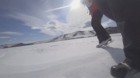 Two travelers go ice skating on a snow-covered lake. To go hard and far. This is a special kind of hike. Shot on the action camera stock footage