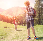 Two travelers going up the hill Royalty Free Stock Photos