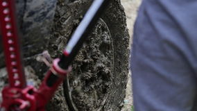 Two travelers replacing wheel of expeditionaty SUV at forest dirty road. stock footage