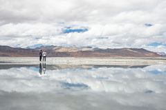 Two travelers stay near the Tso Kar Lake in Himalaya, India, Lad. Kh region Royalty Free Stock Image