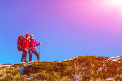Two Travelers staying on grassy mountain ridge and enjoying Nature Stock Images