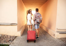 Two travelers on vacation walking around city with luggage. Two travelers on vacation walking around the city with luggage Royalty Free Stock Photography