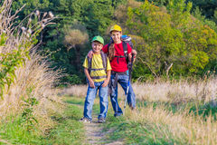 Two traveling kids with backpacks Stock Photos