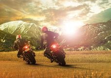 Two traveling motorcycle leaning on sharp curve stock photography