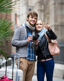 Two travellers with digital camera walking through city street Royalty Free Stock Photos