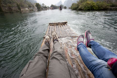 Two travlers rafting in Lijiang Stock Images