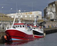 Two trawler fishing boats docked Stock Image