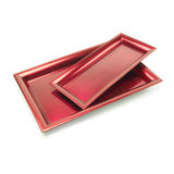 Two trays. Two red trays against white.Clipping path Royalty Free Stock Image