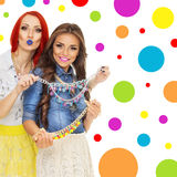 Two trendy young women with colorful necklaces Royalty Free Stock Images