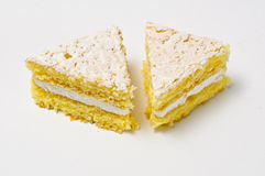 Two triangles of sponge cookies Royalty Free Stock Photo