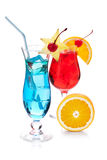Two tropical cocktails and orange Stock Images