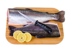 Two trout fishes on wooden plate prepared for lunch Stock Images