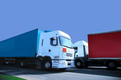 Two trucks. Trucks on the road again Stock Images