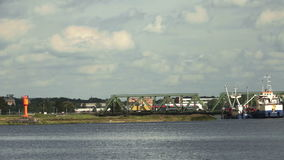 Two trucks crossing the bridge stock video