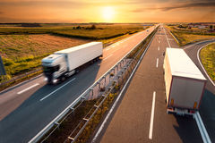 Two trucks on highway in motion blur Stock Photography