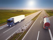 Two trucks in motion blur on highway Royalty Free Stock Photography