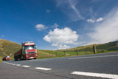 Two trucks on mountain road. Wales Stock Photography