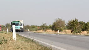 Two trucks overtake. On road stock video footage
